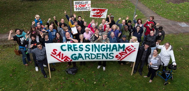 Campaigners and residents of Cressingham Gardens prepare banners and placards for a demonstration against plans to demolish their 40 year old estate in Brixton, London. 11.10.2014.
