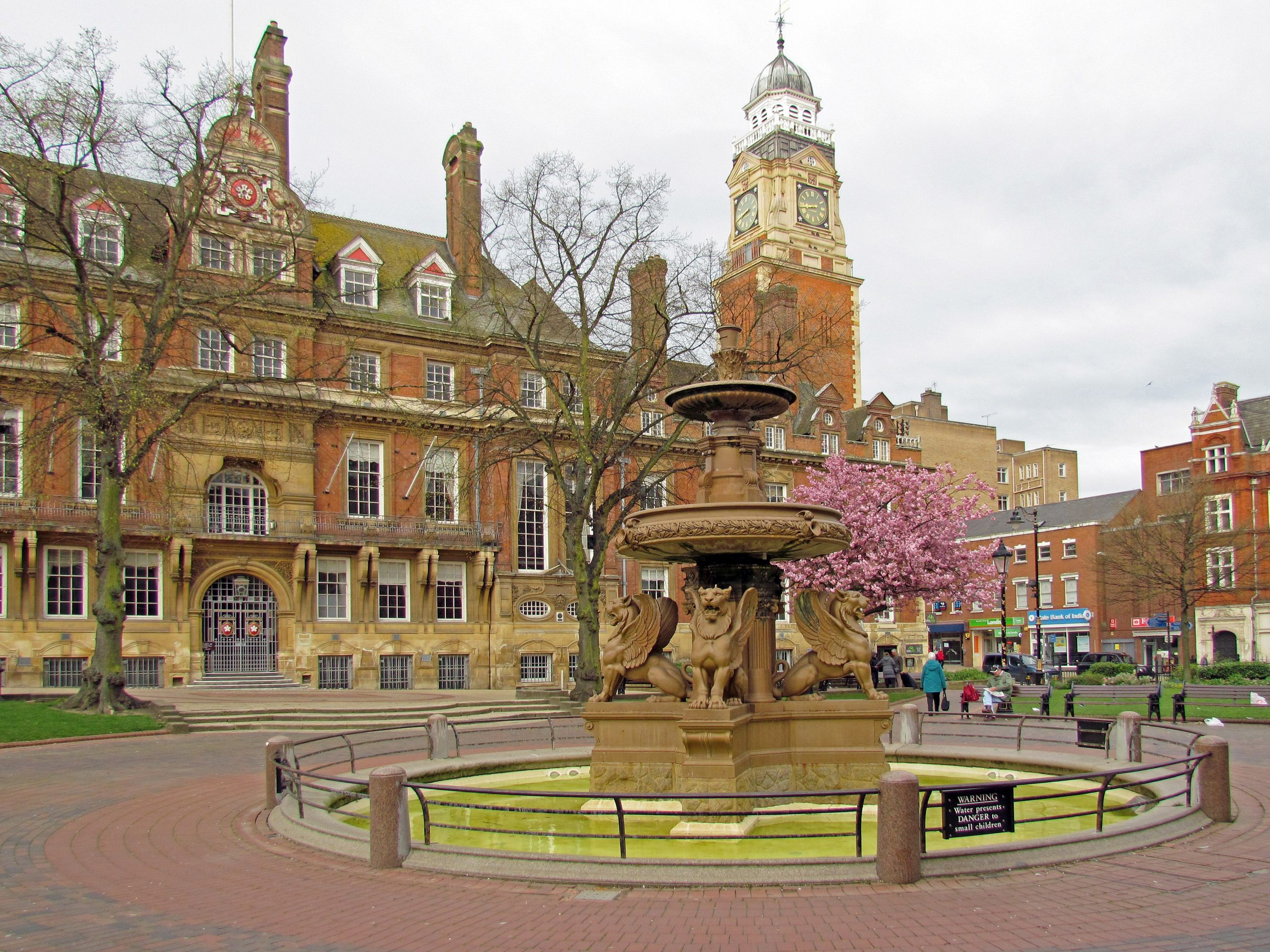 An image of Leicester Town Hall with the Town Hall Square fountain in the foreground.
