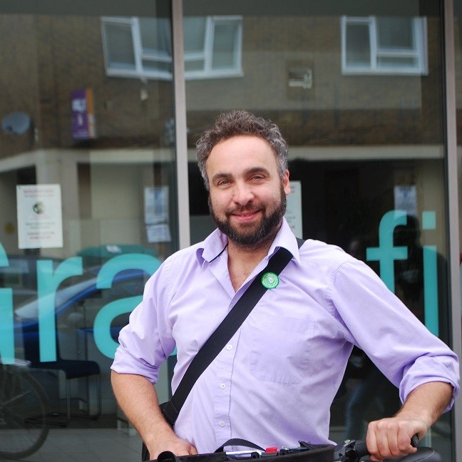 In 2014 Scott was elected as <br> the sole Green councillor in Lambeth <br>and spent the next four years facing down a ruling <br> neoliberal Labour Party as they sought to <br> demolish council estates and turn libraries <br> into gyms. He was re-elected to Lambeth <br> Council along with four fellow Greens <br> in 2018 and in early 2019 Lambeth became the first <br> Council to declare a Climate <br> Emergency.  Scott continues the fight for <br> Climate Action, Clean Air and Londoners' right to <br> a safe, secure and affordable home.