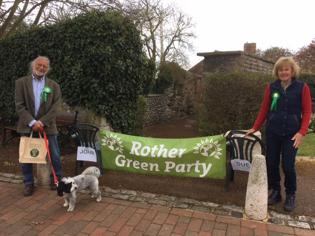 Two members of Rother Green party with local party banner
