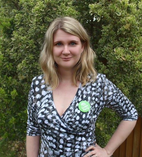 Katie Gerrard wearing a Green Party rosette
