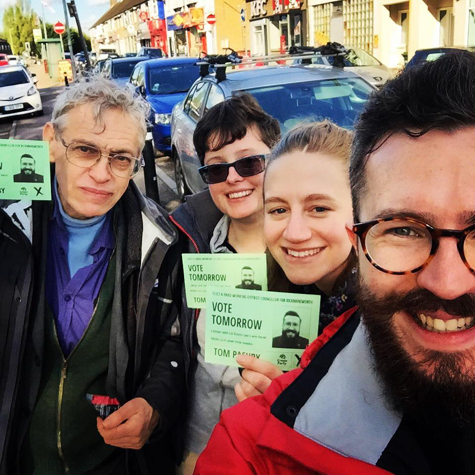 Selfie of four campaigners hold Green calling cards