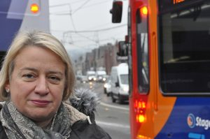Natalie Bennett in front of a passing bus